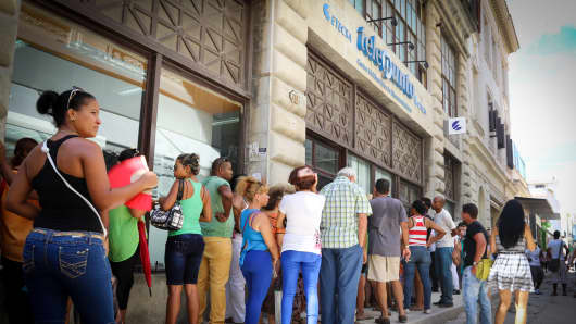 A former Western Union location which is now home to Etecsa, the Cuban telephone company. People here wait in line to purchase internet time.