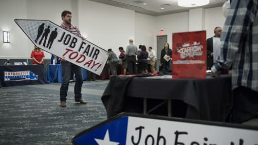 A company representative demonstrates sign spinning at the Choice Career Fair in San Antonio, Texas.