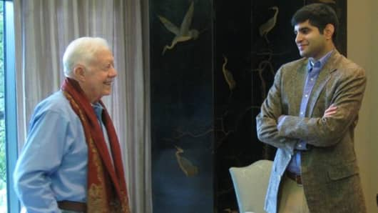 Former President Jimmy Carter and Kabir Sehgal meeting at the Carter Center in Atlanta.
