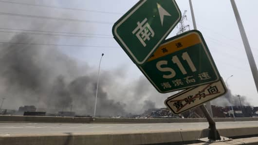 A damaged road sign near the site of the explosions at the Binhai new district, Tianjin, August 13, 2015.