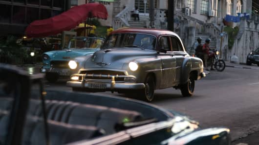 American cars cruise the streets of Havana.