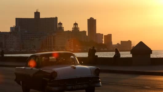 The sun sets over Havana on the evening before the U.S. officially reopens their embassy after 54 years.
