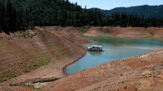 A lone houseboat beside an almost dry section of the Shasta Lake reservoir in California last May.