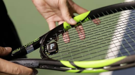 Challenger clips on to four strings near the base of the racket.