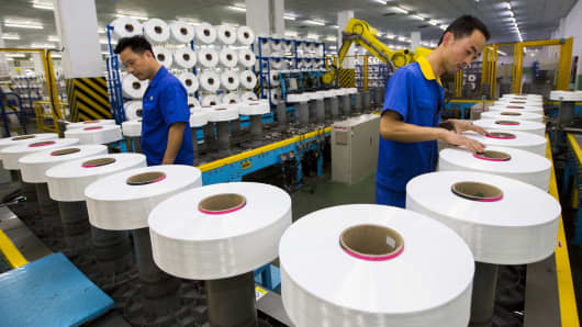 Employees work in a textile factory in Suzhou, China.