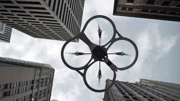 A drone takes flight amid skyscrapers and with an app from start-up FreeSkies. Its software allows operators to program a flight route and captures high-resolution photos and video.