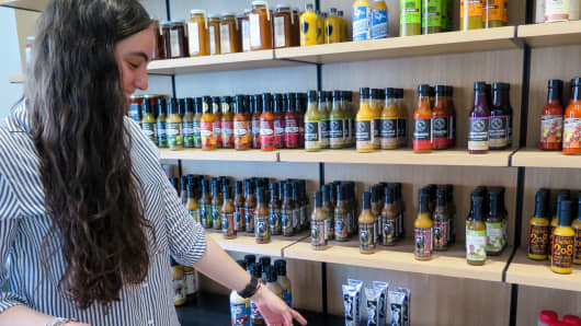 A shopper browses hot sauces at Heatonist in Brooklyn, New York.