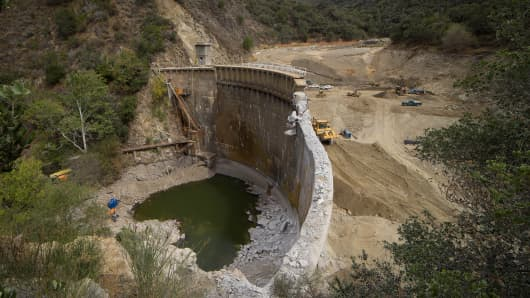 Largest dam removal in California history: workers tearing down the San Clemente Dam in Monterey County.