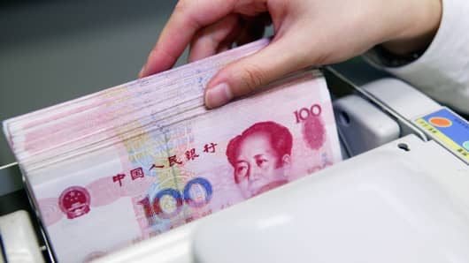 China's currency is expected to fall below its own 'red line,' prompting more complaints from US