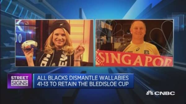 CNBC anchor loses bet, dons All Blacks scarf