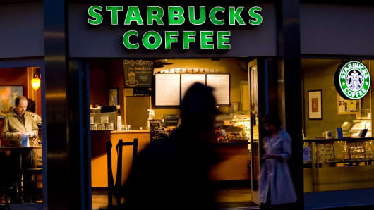 A Starbucks store pictured at night.