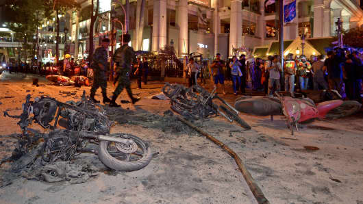 Thai soldiers inspect the scene after a bomb exploded outside a religious shrine in central Bangkok late on August 17.