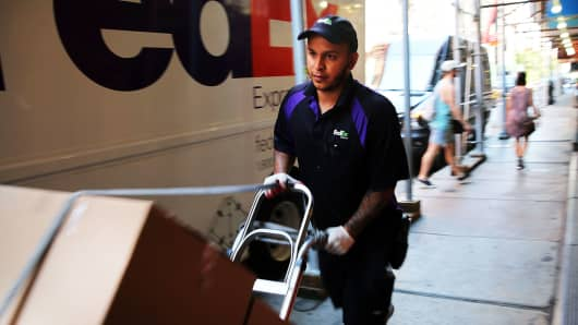 A FedEx employee makes deliveries in New York City.