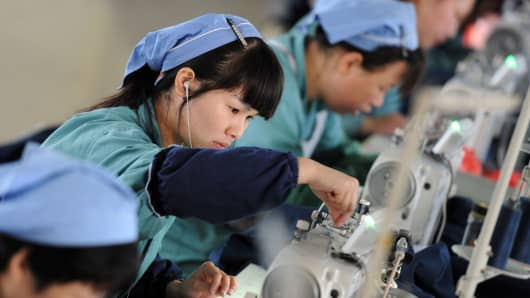 Workers producing clothes in a factory in Huaibei, China.