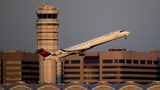 A Delta Air Lines Inc. Canadair CL-600 airplane departs Ronald Reagan National Airport in Washington, D.C.