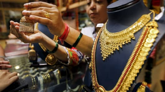 Gold-loving India is buying less due to higher import duties and a jewelers strike.