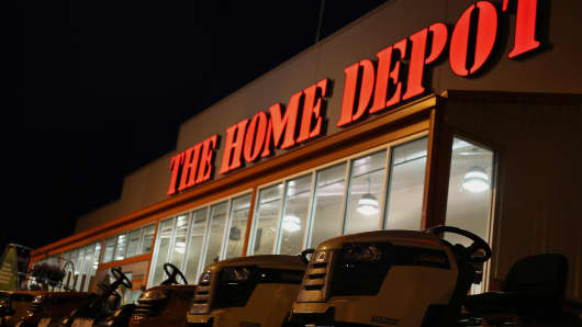 Riding lawnmowers stand in a row in the parking lot outside a Home Depot Inc. retail store in Bowling Green, Kentucky.