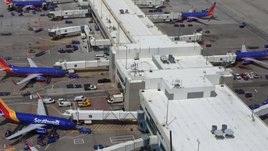 View of Southwest Airlines planes parked at the Denver International Airport.