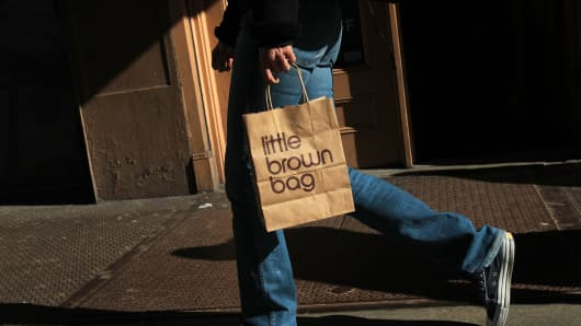 A man carries a shopping bag from the Bloomingdale's store in the SoHo shopping district of Manhattan.