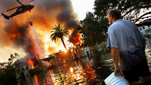 A house burns as Hurricane Katrina ravaged New Orleans, 2005.
