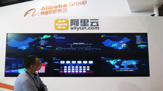 An exhibitor looks at Alibaba's Aliyun.com device in Beijing, China.