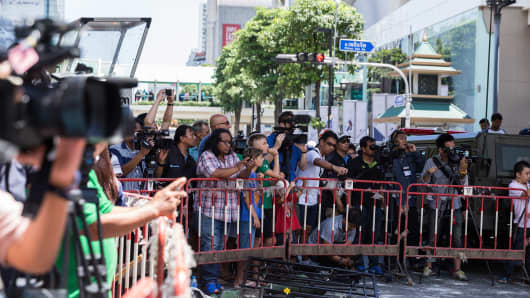Onlookers near the site of a bomb explosion that took place on August 17, 2015 in Bangkok