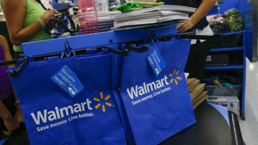 A cashier scans school supplies for a customer at a Wal-Mart Stores Inc. location in the Porter Ranch neighborhood of Los Angeles, California