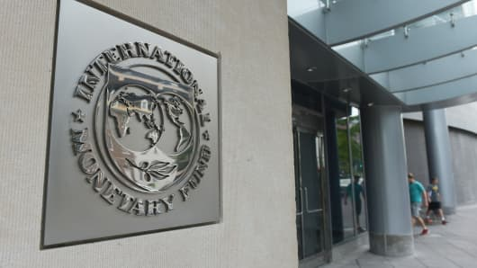 The seal of the International Monetary Fund is seen on a headquarters building in Washington, DC.