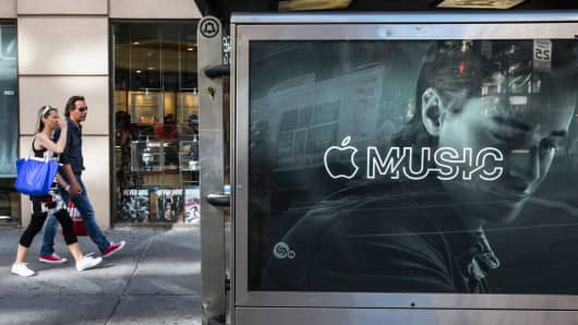 An advertisement for Apple Music is posted on a street in New York.