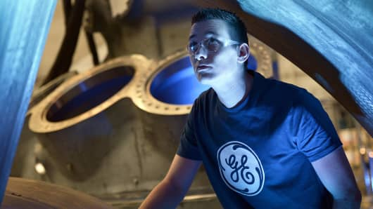 A worker looks at the 9HA Gas Turbine, at the General Electric plant in Belfort, France.