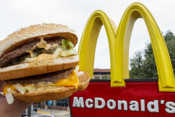 A McDonald's Big Mac, their signature sandwich is held up near the golden arches in Centerville, Virginia.