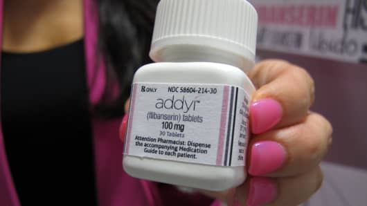 Sprout Pharmaceuticals CEO Cindy Whitehead holds a bottle for the female sex-drive drug Addyi.