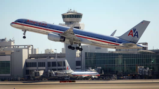 An American Airlines plane takes off at the Miami International Airport.