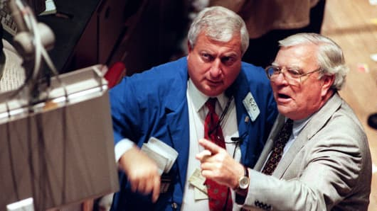 A trader (left) and a specialist on the floor of the New York Stock Exchange on a day when the Dow Jones industrial average fell 222 points, in January 1998.