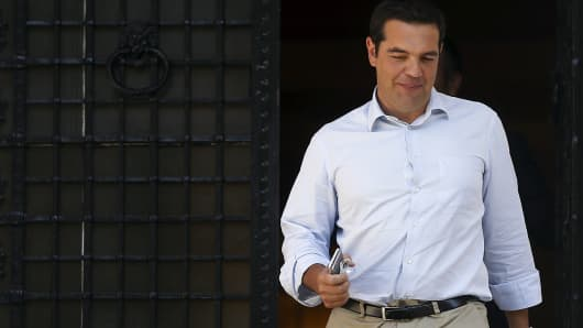 Greek Prime Minister Alexis Tsipras leaves his office at Maximos Mansion in Athens, Greece, August 20, 2015.