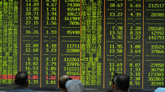 Investors observe the stock market at an exchange hall in Hangzhou, Zhejiang Province of China.