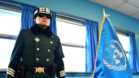 A South Korean soldier stands guard inside of a UN conference building in the Demilitarized Zone dividing the two Koreas last February.