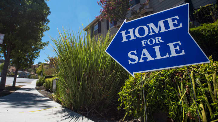 A 'Home For Sale' sign is displayed outside a house in Martinez, Calif.