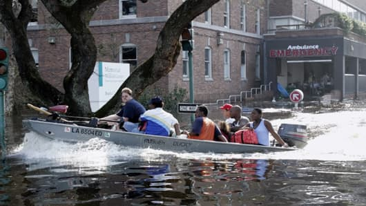 Patients and staff of the Memorial Medical Center in New Orleans are evacuated by boat after floodwater surrounded the facility on Aug. 31, 2005.