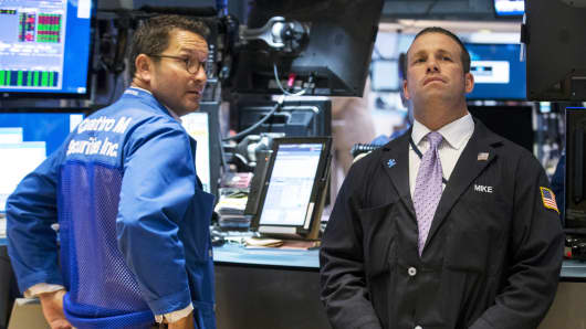 Traders work on the floor of the New York Stock Exchange, August 25, 2015.