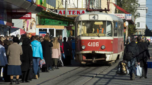People queue up for a tram in a shopping area in Donetsk, Ukraine.