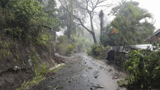 Debris covers a road after heavy rains from Tropical Storm Erika hit the Caribbean island of Dominica in this picture from Robert Tonge, Dominican Minister for Tourism and Urban Renewal, taken August 27, 2015.