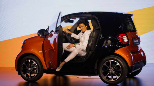Annette Winkler, head of Daimler AG's Smart brand, unveils the Smart Fortwo city vehicle during the 2015 New York International Auto Show last April.