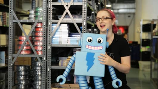 Limor Fried, founder of Adafruit Industries, holds up Adabot, a character in her company's videos that teach electrical engineering concepts.