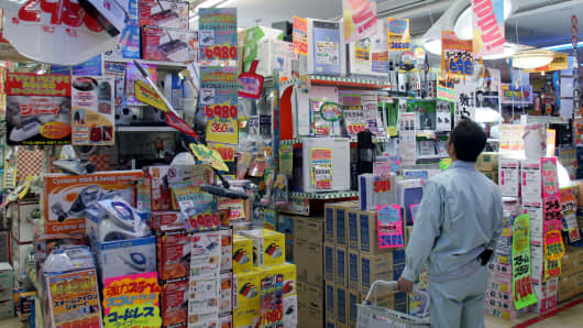 A Don Quijote customer looks at goods at one of the discount chain's stores in Tokyo, Japan.