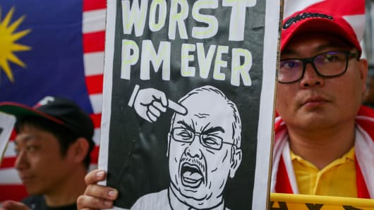Protesters hold up a placard during a Bersih rally as protestors call for the resignation of Prime Minister Najib Razak on August 30, 2015 in Kuala Lumpur, Malaysia.