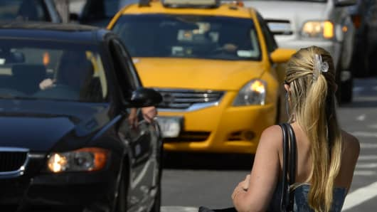 Taxis come down Second Avenue in New York.
