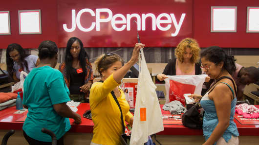 Employees assist customers at a J.C. Penney store at the Gateway Shopping Center in Brooklyn, New York.