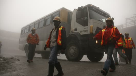 Workers arrive at Freeport McMoRan's Grasberg mining complex, in Indonesia's remote eastern Papua province.