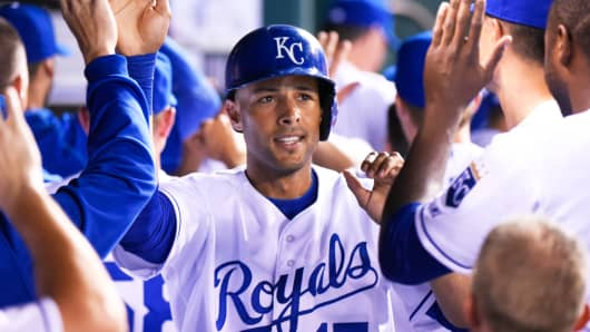 Alex Rios of the Kansas City Royals celebrates with teammates during a game in Kauffman Stadium in Kansas City in July.